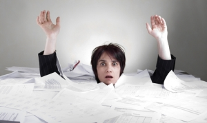 Woman drowning in papers
